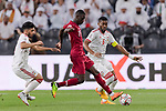 Almoez Ali of Qatar (C) fights for the ball with Fares Juma Al Saadi of United Arab Emirates (R) during the AFC Asian Cup UAE 2019 Semi Finals match between Qatar (QAT) and United Arab Emirates (UAE) at Mohammed Bin Zaied Stadium  on 29 January 2019 in Abu Dhabi, United Arab Emirates. Photo by Marcio Rodrigo Machado / Power Sport Images