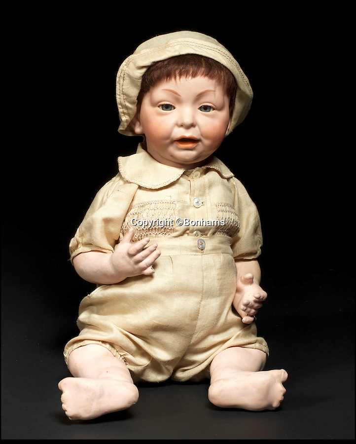 BNPS.co.uk (01202 558833)<br /> Pic: Bonhams/BNPS<br /> <br /> ***Please Use Full Byline***<br /> <br /> Kammer & Keinhardt Bisque Head Character Baby with Glass Eyes. <br /> <br /> <br /> A creepy collection of almost 100 'lifelike' dolls modelled on children has emerged for sale with a whopping half a million pounds price tag. <br /> <br /> The eerie-looking toys were made in Germany in the early 20th century as dollmakers strived to produce dolls with realistic human features.<br /> <br /> The collection of 92 dolls, which includes some of the rarest ever made, has been pieced together by a European enthusiast over the past 30 years.<br /> <br /> It is expected to fetch upwards of £500,000 when it goes under the hammer at London auction house Bonhams tomorrow (Weds).