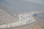 Traffic moves along I-580, just south of Reno, as heavy smoke from the Rim fire hangs over Northern Nevada on Friday, Aug. 23, 2013. <br /> Photo by Cathleen Allison