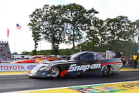 May 31, 2013; Englishtown, NJ, USA: NHRA funny car driver Cruz Pedregon (near lane) races alongside Johnny Gray during qualifying for the Summer Nationals at Raceway Park. Mandatory Credit: Mark J. Rebilas-