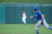 Orem Owlz left fielder Johan Sala (25) prepares to make a catch during a Pioneer League game against the Ogden Raptors at Home of the OWLZ on August 24, 2018 in Orem, Utah. The Ogden Raptors defeated the Orem Owlz by a score of 13-5. (Zachary Lucy/Four Seam Images)
