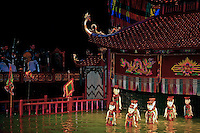 """Vietnamese water puppets at the puppet show in  Hanoi.  Though water puppet shows were originally amusement for rice farmers, using rice paddies for the """"stage"""", they have become a big hit, especially in Hanoi."""