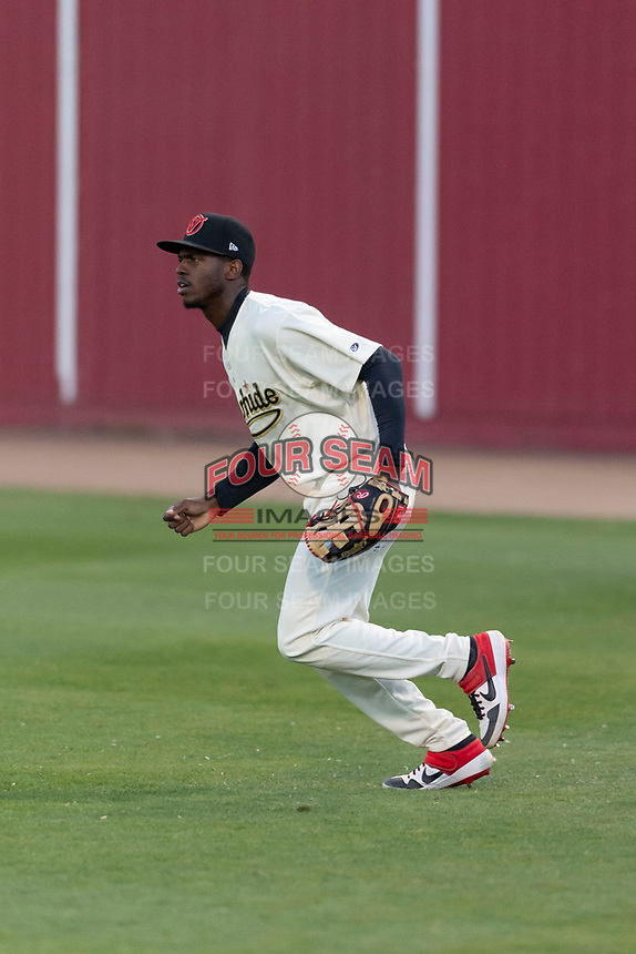 Visalia Rawhide right fielder Anfernee Grier (10) during a California League game against the Rancho Cucamonga Quakes on April 9, 2019 in Visalia, California. Visalia defeated Rancho Cucamonga 8-5. (Zachary Lucy/Four Seam Images)