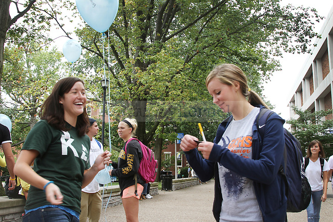 Hope Johnson, left, from Kappa Delta sorority, gave a sticker to secondary math junior Rachel Crawford in honor of International Women's Friendship Month to boost women's confidence, outside of White Hall Classroom Building in Lexington, Ky., Sept. 20, 2011. Photo by Becca Clemons | STAFF