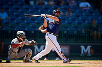 Mississippi Braves Andy Wilkins (32) at bat in front of catcher Rodrigo Vigil (1) during a Southern League game against the Jacksonville Jumbo Shrimp on May 5, 2019 at Trustmark Park in Pearl, Mississippi.  Mississippi defeated Jacksonville 1-0 in ten innings.  (Mike Janes/Four Seam Images)