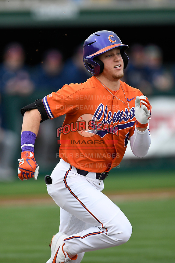 Right fielder Michael Green (11) of the Clemson Tigers runs out a batted ball in a game against the South Alabama Jaguars on Opening Day, Friday, February 15, 2019, at Doug Kingsmore Stadium in Clemson, South Carolina. Clemson won, 6-2. (Tom Priddy/Four Seam Images)