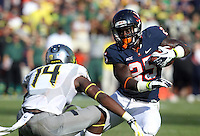 DUPLICATE***Virginia safety David Marrs (25)***Virginia running back Kevin Parks (25), DUPLICATE***Oregon quarterback Dustin Haines (14)***Oregon cornerback Ifo Ekpre-Olomu (14) Oregon defeated Virginia 59-10 during an NCAA college football game at Scott Stadium, Saturday, Sept. 7, 2013, in Charlottesville, Va. (Photo/Andrew Shurtleff)