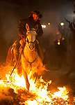 SAN BARTOLOME DE PINARES, SPAIN - JANUARY 16: A man rides a horse through a bonfire on January 16, 2013 in San Bartolome de Pinares, Spain. In honor of San Anton, the patron saint of animals, horses are riden through the bonfires on the night before the official day of honoring animals in Spain. Victor J. Blanco / Alterphotos