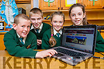 Pat mhony, Patrick Fitzgerald, Emma Kerin and Shauna Tangney pupils of Scartaglen NS looking at the schools new website scartaglenns.ie on Thursday