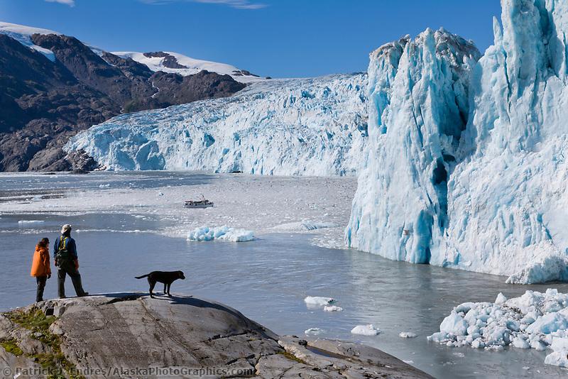 Hiking along the rocky shore of Chenega glacier, Prince William Sound, Alaska.