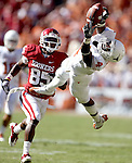 Texas' cornerback Aaron Williams (4) stretches for a pass intended for Oklahoma's Ryan Broyles (85) but was not able to make the play in the second quarter during their game at the Cotton Bowl in Dallas, Texas, Saturday, October 2, 2010. Oklahoma won 28-20. (Star-Telegram/Khampha Bouaphanh)