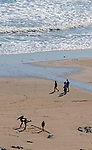 Swansea, UK, 25th March 2020.<br />People enjoying the sunny weather at Langland Bay near Swansea this afternoon despite government warnings asking people to stay at home due to the Coronavirus outbreak in the UK.