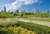 Bike Riders cruise along the bike path through the Museum Campus area on Chicago's Lakefront in summer