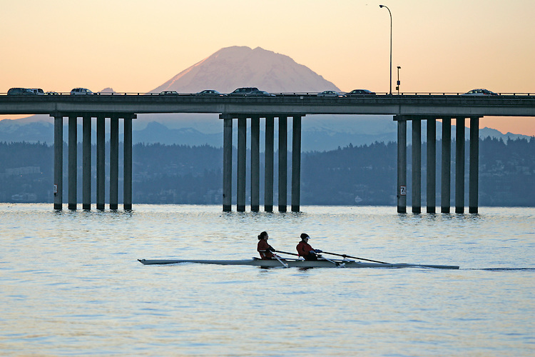 Seattle, Rowing, US Olympic (2008) rowers Lia Pernell (bow)(left), Anna Mickelson, workout in a women's double, Lake Washington, Mount Rainier, winter, Washington State, Pacific Northwest, USA.