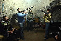Photographer: Rick Findler..27.04.12 Members of the Free Syrian Army pose for pictures in a cave hidden in a mountain in Northern Syria. They have lived in the cave for the past three months but had only installed electricity yesterday. Most of the soldiers that sleep here are defectors of Assad's army.