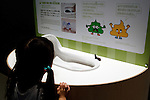 """A girl sees a Japanese toilet at the Toilet!? Human Waste & Earth's Future exposition on August 1, 2014 in Tokyo, Japan. The Toilet!? Human Waste & Earth's Future is an exposition to listen the toilet's voice and explore what is the """"happy toilet"""" for each human being on the earth at National Museum of Emerging Science and Innovation in Tokyo from July 2 to October 5. The toilet is related not only to our daily life but also to the global environment. The exposition consist of eight areas where you can learn toilet problems for each generation and in the world. (Photo by Rodrigo Reyes Marin/AFLO)"""