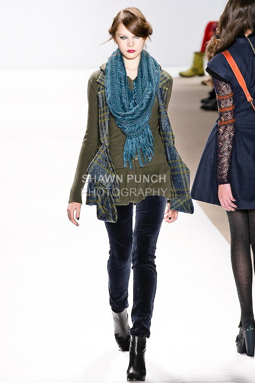 Kristina Krivomazova walks the runway in a cypress plaid vest, olive hooded sweater, and carbon velveteen pants, by Nanette Lepore, for her Nanette Lepore Fall 2010 collection fashion show, during Mercedes-Benz Fashion Week Fall 2010.