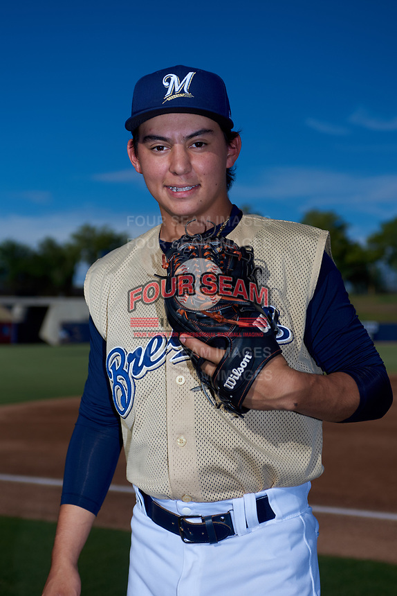 AZL Brewers Gold Mario Perez (10) poses for a photo before an Arizona League game against the AZL Brewers Blue on July 13, 2019 at American Family Fields of Phoenix in Phoenix, Arizona. The AZL Brewers Blue defeated the AZL Brewers Gold 6-0. (Zachary Lucy/Four Seam Images)