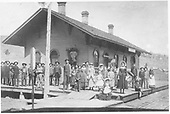 A large crowd on the platform at the D&amp;RG Placer depot.<br /> D&amp;RG  Placer (later Russell), CO