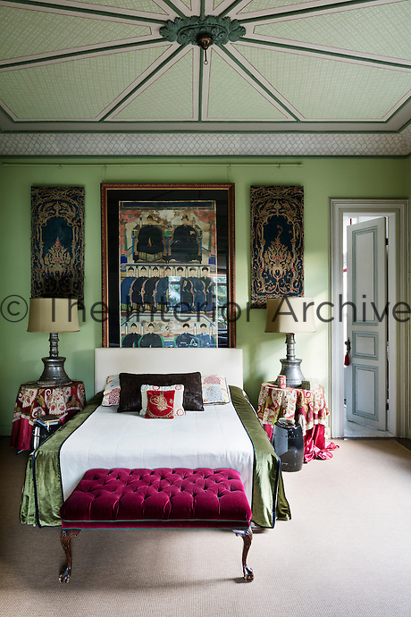 In the green bedroom, layers of patterns and textiles combine with antiquities to create a mix that embodies a sophisticated and bold style.
