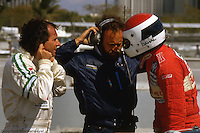 Teammates Emerson Fittipaldi (left) and Bobby Rahal (right) confer in the pit lane during practice for the Lowenbrau Grand Prix of Miami on the temporary street circuit in Bicentennial Park in Miami, Florida.