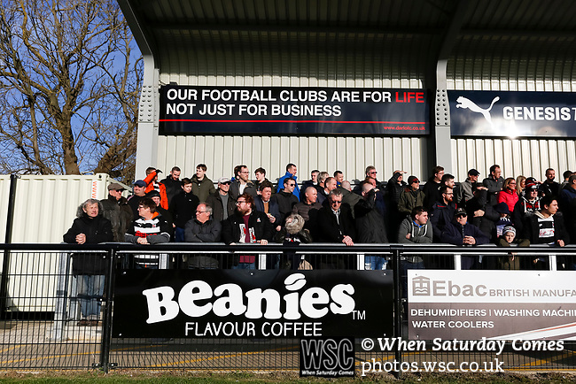 Darlington fans in The Tin Shed End. Darlington 1883 v Southport, National League North, 16th February 2019. The reborn Darlington 1883 share a ground with the town's Rugby Union club. <br /> After several years of relegations, bankruptcies, and ground moves, the club is fan owned, and back on an even keel in the National League North.<br /> A 0-0 draw with Southport was marred by a broken leg and dislocated knee suffered by Sam Muggleton, Darlington's on loan left back.<br /> Both teams finished the season in lower mid table.