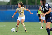 27 August 2011:  FIU's Marie Egan (13) looks to pass the ball in the first half as the FIU Golden Panthers defeated the University of Arkon Zips, 1-0, at University Park Stadium in Miami, Florida.