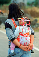 Mother with  child in a baby carrier, Hong Kong