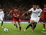 Alex Oxlade-Chamberlain of Liverpool and Steven N'Zonzi of Sevilla during the Champions League Group E match at the Anfield Stadium, Liverpool. Picture date 13th September 2017. Picture credit should read: Simon Bellis/Sportimage