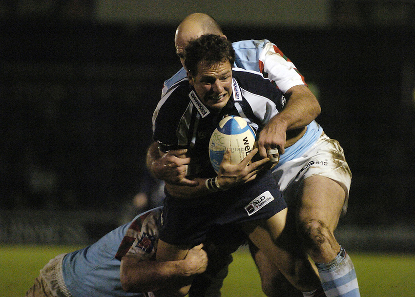 Photo: Jonathan Butler..Bristol Rugby v Bayonne. European Challenge Cup. 15/12/2006..Marko Stanojevic of Bristol is tackled by two Bayonne defenders.