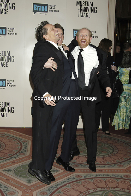 Brian Grazer, Jim Carrey and Ron Howard ..at The Museum Of The Moving Image Salute to Ron Howard on December 4, 2005 at The Waldorf Astoria Hotel. ..Photo by Robin Platzer, Twin Images