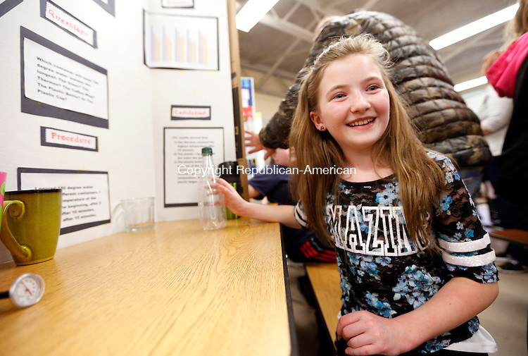 Prospect, CT- 10 April 2015-041015CM02-  Jamie-Lynn Shaffer 9, a third grade student at Algonquin School talks about her project during the 20th annual science fair in Prospect on Friday.  Shaffer's hypothesis was to determine which container would keep 180 degree water warmer the longest.  Shaffer determined that a thermos did the best out of the other containers she tested.  Approximately 100 children participated in the science fair, which included students from five of the school's third graders said Deb Pannone, a third grade teacher at the school.  Pannone added that students used a combination of their  subjects to complete their projects, which they had been working on for two months.  Christopher Massa Republican-American