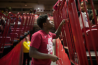 NWA Democrat-Gazette/CHARLIE KAIJO Arkansas Razorbacks guard Jaylen Barford greets a fan during an NCAA selection show, Sunday, March 11, 2018 at Bud Walton Arena in Fayetteville. The Razorbacks will play Butler in Detroit on Friday