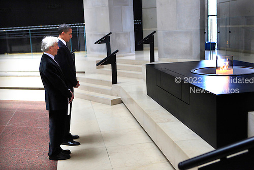 United States President Barack Obama and Elie Wiesel at the Hall of Rememberance at the U.S. Holocaust Memorial Museum in Washington DC on April 23, 2012..Credit: Dennis Brack / Pool via CNP
