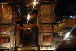 Filipino passengers in the back of a jeepney in Manila, Philippines..**For more information contact Kevin German at kevin@kevingerman.com