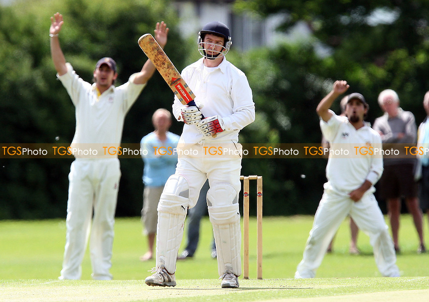 A Roberts (left) and H Afridi of GPR appeal unsuccessfully  for the wicket of Chingford batsman J Hill - Gidea Park & Romford CC vs Chingford CC - Essex Cricket League - 14/06/08 - MANDATORY CREDIT: Gavin Ellis/TGSPHOTO - Self billing applies where appropriate - Tel: 0845 094 6026