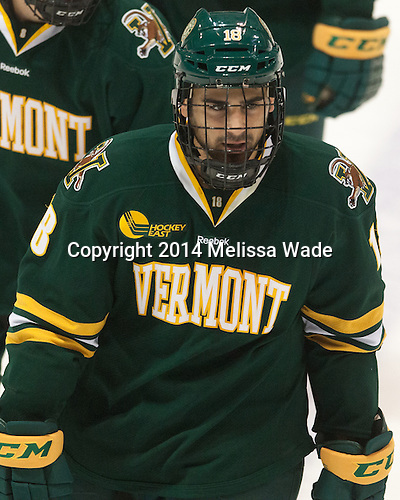 Alexx Privitera (UVM - 18) - The visiting University of Vermont Catamounts defeated the Northeastern University Huskies 6-2 on Saturday, October 11, 2014, at Matthews Arena in Boston, Massachusetts.