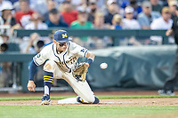 Michigan Wolverines third baseman Blake Nelson (10) catches a throw from the outfield against the Vanderbilt Commodores during Game 1 of the NCAA College World Series Finals on June 24, 2019 at TD Ameritrade Park in Omaha, Nebraska. Michigan defeated Vanderbilt 7-4. (Andrew Woolley/Four Seam Images)