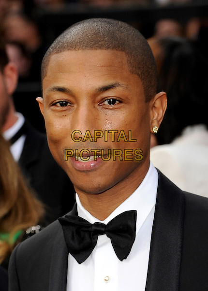 HOLLYWOOD, CA - MARCH 2: Pharrell Williams arriving to the 2014 Oscars at the Hollywood and Highland Center in Hollywood, California. March 2, 2014.  <br /> CAP/MPI/mpi99<br /> &copy;mpi99/MediaPunch/Capital Pictures