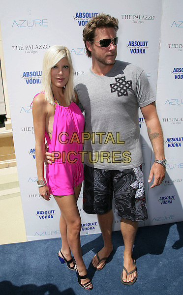 "TORI SPELLING & DEAN McDERMOTT .""Absolute Saturday"" at Azure inside the Palazzo Resort Hotel and Casino, Las Vegas, Nevada, USA, .5th September 2009.full length pink playsuit black patent heels sandals open toe cuff bracelet gold wrist watch  grey gray t-shirt shorts flip flops married couple husband wife .CAP/ADM/MJT.©MJT/Admedia/Capital Pictures"