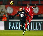 Nederland, Enschede, 19 januari 2013.Eredivisie.Seizoen 2012-2013.FC Twente-RKC Waalwijk.Douglas (r.) van FC Twente kopt de bal weg voordat Mart Lieder (l.) van RKC Waalwijk eraan kan komen.
