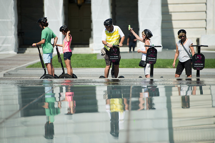 UNITED STATES - JUNE 22: Tourists on Segways stop on the East Plaza of the Capitol for a rest and photos on Monday, June 22, 2015. (Photo By Bill Clark/CQ Roll Call)