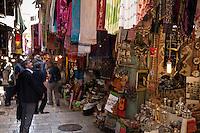 Goods of all types hem in the walkways in the Arab Bazaar of Jerusalem