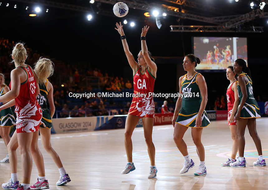 29.07.2014 Wales' Cara Lea Moseley in action during the South v Wales netball match at the Commonwealth Games Glasgow Scotland on the 29th of July 2014. Mandatory Photo Credit ©Michael Bradley.