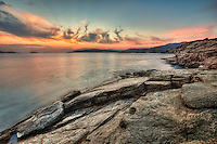 The sunset from a rocky location in Andros, Greece