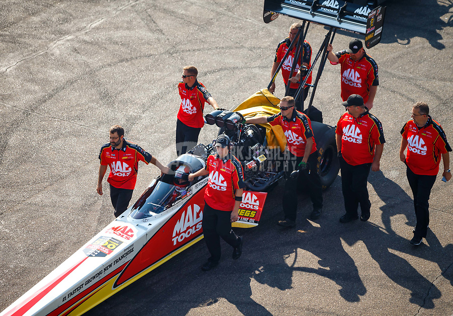 Aug 19, 2017; Brainerd, MN, USA; NHRA top fuel driver Doug Kalitta is pushed by crew members during qualifying for the Lucas Oil Nationals at Brainerd International Raceway. Mandatory Credit: Mark J. Rebilas-USA TODAY Sports