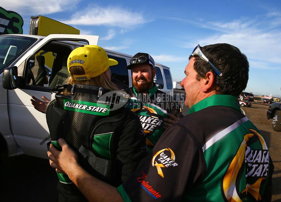 Feb 28, 2016; Chandler, AZ, USA; NHRA top fuel driver Leah Pritchett celebrates with crew members after winning the Carquest Nationals at Wild Horse Pass Motorsports Park. Mandatory Credit: Mark J. Rebilas-