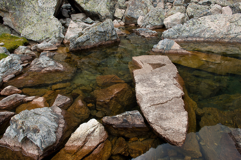 Boulder formations in Colorado's pristine Rocky Mountain waters, as created naturally by stronger forces into abstract still lifes.