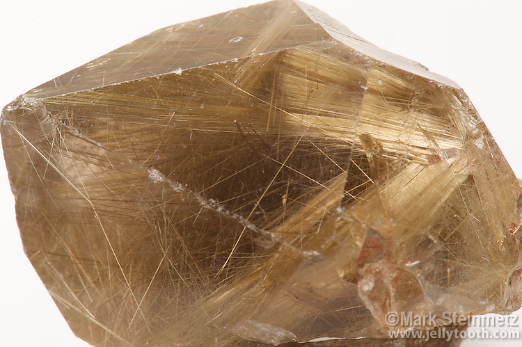 Rutilated Quartz Crystal, Brazil. Rutilated quartz is rock crystal quartz formed with rutile needle-like crystal inclusions, which also impart the color. Rutile is a mineral composed mostly of titantium dioxide.