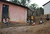 Lencois, Bahia State, Brazil. Poor family outside their simple house on the edge of the village.